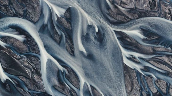 ICELAND WILDERNESS: Pictures of Iceland's river system from above. Like a scene from a sci-fi movie you could be mistaken for thinking you are looking at an alien planet.  However these pictures were in fact taken right here on Earth.  From around 3,000feet-high above the landscape, these pictures show the view of Southern Iceland's river system.  Abstract lines and contours of the volcanic black sands and icy waters make for amazing visual spectacle that could fool any observer into thinking these were images from foreign worlds. French photographer Emmanuel Coupe-Kalomiris (39) described his expedition of Iceland from above.