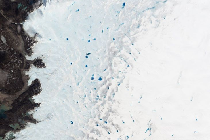 in-spring-blue-ponds-speckle-southwest-greenland-as-ice-melts-the-size-and-number-of-these-ponds-help-track-how-much-the-ice-sheet-is-melting-each-year