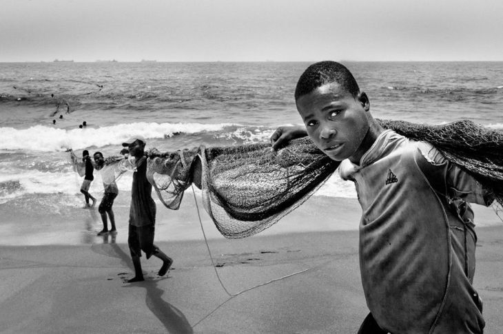 sub-saharan-africa-winner-in-togo-these-men-place-large-nets-in-the-water-for-fishing-which-then-need-to-be-pulled-onto-the-beach-by-dozens-of-people-the-fish-caught-are-small-and-scarce