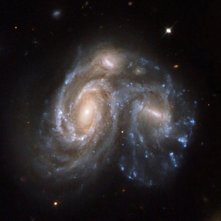 this-spectacular-snapshot-in-time-shows-two-galaxies-in-the-process-of-merging-together-it-is-part-of-a-series-of-59-images-released-in-2008-showing-different-stages-of-galaxy-merging-before-during-and-after-this-is-one-o