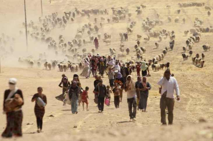 as-the-islamic-state-aka-isis-group-advanced-across-iraq-people-of-the-minority-yazidi-sect-seen-as-infidels-by-isis-fled-toward-the-syrian-border-with-hopes-of-eventually-reaching-kurdish-territory-here-th-75