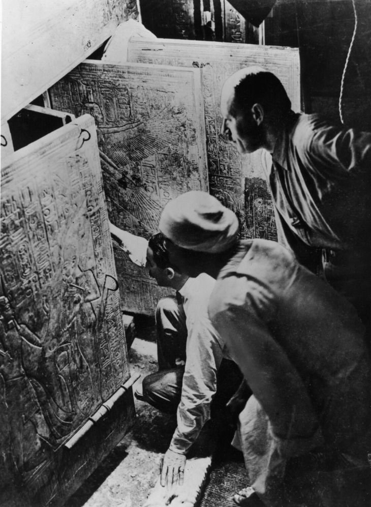 British archaeologist and Egyptologist Howard Carter (1874 - 1939) (left) and his assistant Arthur Callender (right) opening the entrance to the fourth chamber of Tutankhamen's tomb, February 1923. (Photo by Hulton Archive/Getty Images)