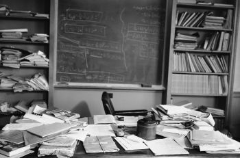 Familiar pipe on an open book, a cluttered desk and a blackboard covered with mathematical equations surround the empty chair in Dr. Albert Einstein's office at the Institute for Advanced Study, at Princeton, New Jersey on April 18, 1955. The famous physicist died of a gall bladder ailment at the age of 76. (AP Photo/Jacob Harris)
