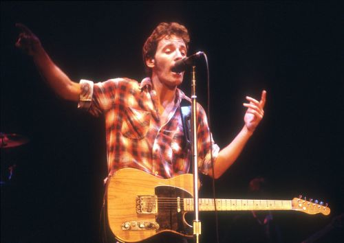 Springsteen playing in a flannel