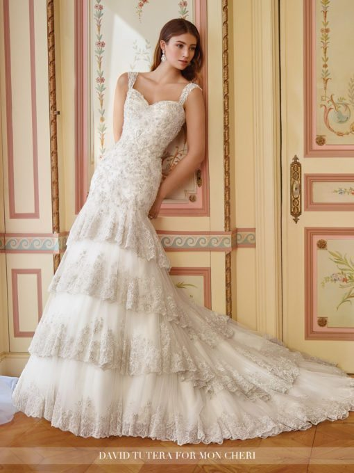 The tiered skirt on this design is so wonderfully unique and romantic, we can't help but think of Romeo's Juliet!