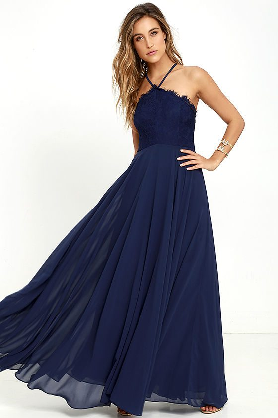 We're loving the lace bodice on this gown and it's inclusion of the flowing, steady skirt.