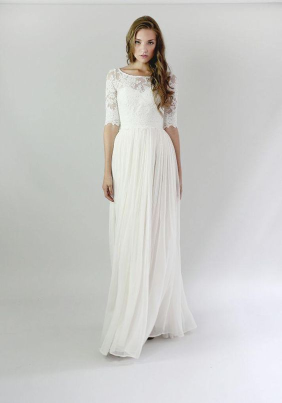 This one has lace too, with beautiful sleeves and a skirt that would be glorious twirling around not he dance floor.