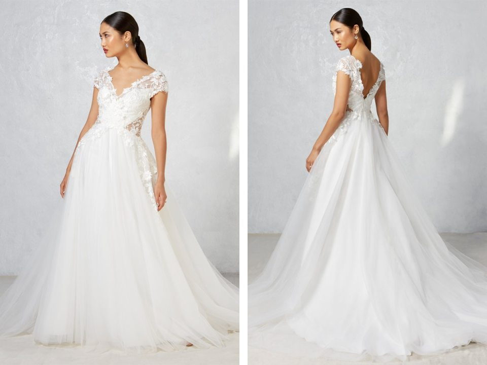 Between the peek-a-book sides, the lace and the flowing skirt, there are so many elements of this gown that you'll fall head-over-heels in love with.
