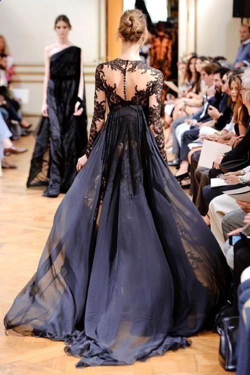 Check out this design and all its gorgeous artistry, from the sleeves to the flowing skirt!