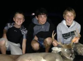 Diego poses with host brothers Tate and Troy on a hunting trip. (He's not too sure about the buck!)