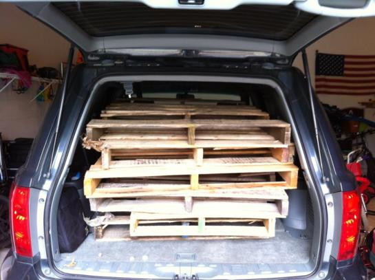 car full of wood pallets - for basement finishing
