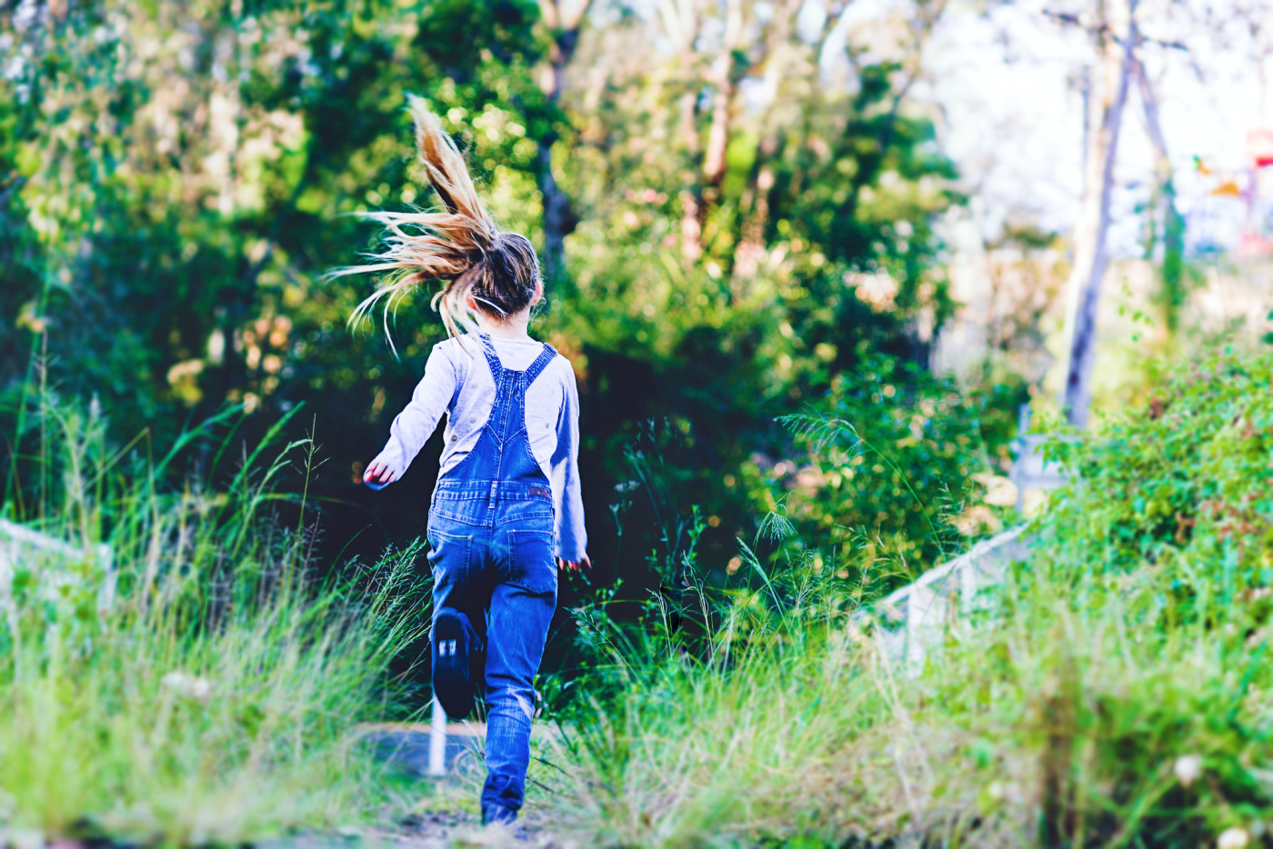 Photographersydney/girl at old bridge wearing denim overalls