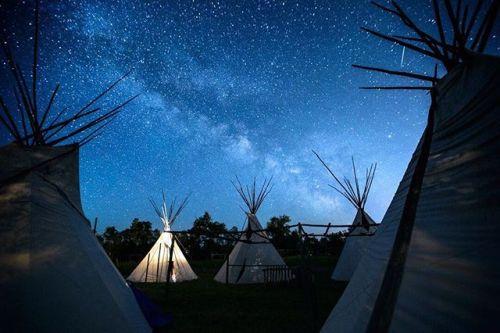 The Milky Way rises over teepees on the Crow Reservation in Montana. This teepee camp forms the heart of the Nat Geo Photo camp that took place on the Crow Reservation in Montana last week. It has been a dream of mine to bring the photo camp home to the tribe that adopted me 20 years ago. Follow @ngphotocamp for some great work from our Apsáalooke students! Thanks to our staff @dguttenfelder @stacygold @jeannemodd @jj.stratton @jimwebb @_mallorybenedict @aaronbbrien @brienja