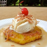 Grilled Pineapple with Ice Creamm, Rum Sauce and Toasted Coconut