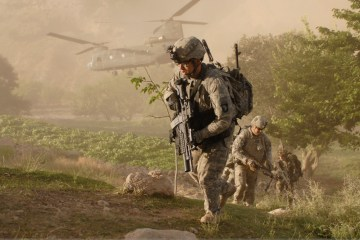 Soldiers from A Company, 101st Division Special Troop Battalion air assault into a village inside Jowlzak valley, Parwan province, Afghanistan. Afghan National Police searched the village while Soldiers provided security and conducted key-leader engagements.
