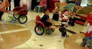 Kid robots pulling rickshaw