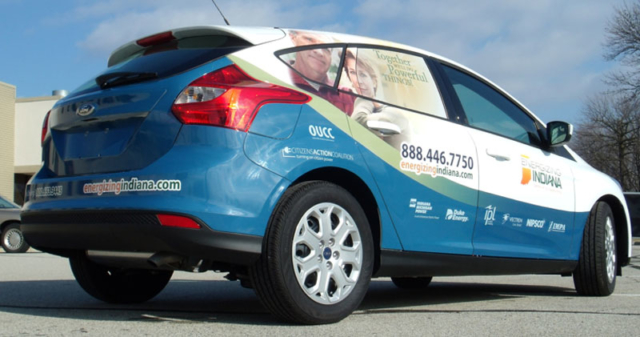 full vehicle wrap, energizing indiana wrap, business vehicle wraps, perf window graphics