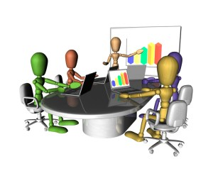 A group of multicoloured figures at a business meeting. One is presenting at the front of the room.3D objects created especially for this series of illustrations by the artist.
