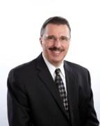 Dennis Slater, President and Secretary, AEM