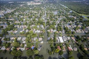 Governor's Commission to Rebuild Texas: An aerial view shows extensive flooding from Harvey in a residential area in Southeast Texas, Aug. 31, 2017. Air National Guard photo by Staff Sgt. Daniel J. Martinez