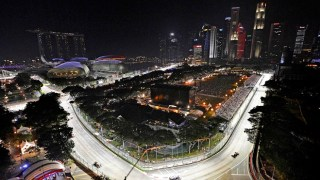 Cars race in the Singapore Formula One Grand Prix on the Marina Bay City Circuit in Singapore as seen from Swissotel The Stamford, Sunday, Sept. 23, 2012. (AP Photo / Bryan van der Beek)