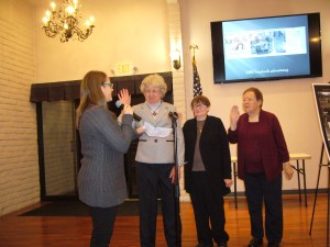 (L to R) --Taking their oath President: Valeria Roach Treasurer: Barbara Borg-Jenkins Vice President: Anne Koehler With Jenny at the microphone.