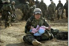 Soldier cares for baby