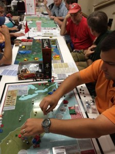 Part of the GMT Demo Area at WBC. There's Jordan playing Liberty or Death, Volko with Fire in the Lake, Hermann Luttman with At Any Cost, and way in the back, Sal Vast with Unconditional Surrender.