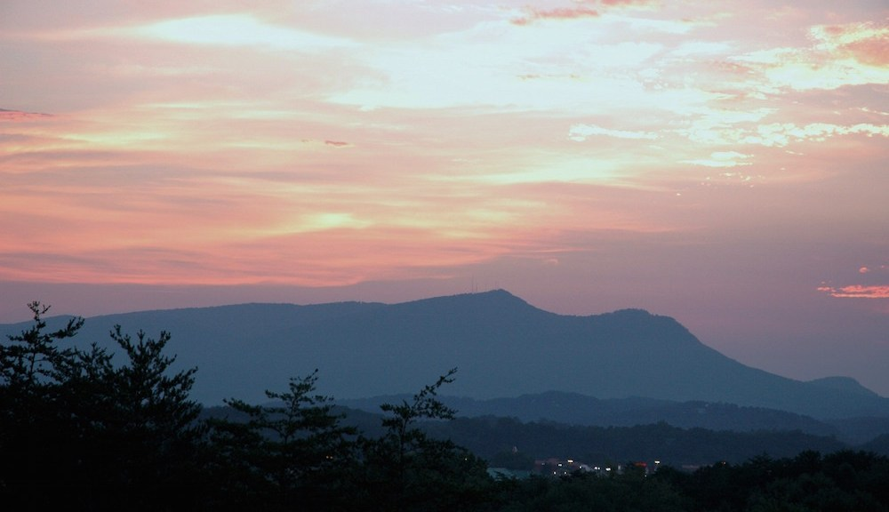 Sunset in Pigeon Forge over mountains