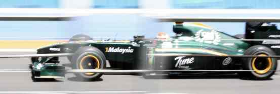 Green Lotus Car During Valencia Formula One Grand Prix