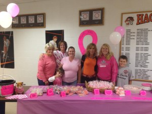 Volunteers man the bake sale table at the Oct. 2 Pink volleyball game at Hackettstown High School. The sale raised $203 toward the team's $1,000 fundraising goal to benefit the Joan Knechel Cancer Center at Hackettstown Regional Medical Center.