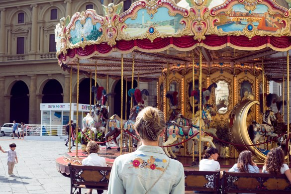 Florence, Italy Jenelle of Inspiring Wit standing in front of carousel