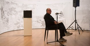 "Alvin Lucier recording ""I am sitting in a room"" at the Museum of Modern Art in New York, NY on Saturday, December 20, 2014. Assisted by James Fei and accompanied by his wife Wendy Stokes. (photographed and copyright by Amanda Lucier)"