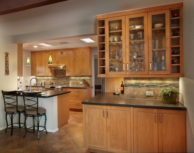 kitchens kitchen remodeling tucson az Black slate countertops Shaker Craft Classic Natural cherry cabinetry with black quartz countertops Glass tile and travertine Modern Kitchen remodel