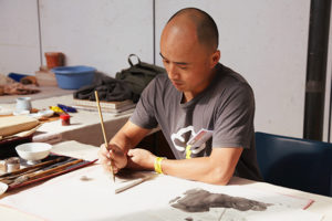 Hung Fei at work in the Demonstrator workspace