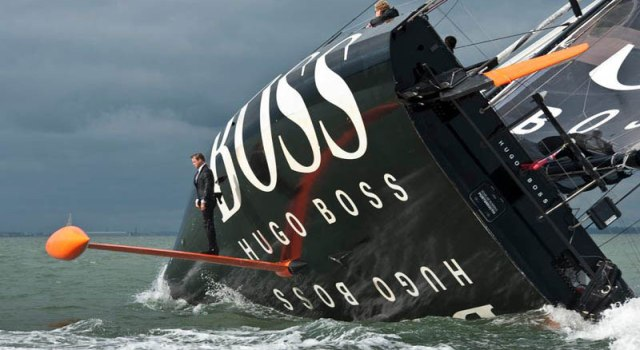 keel-walk-hugo-boss-suit-boat-sailing-standing-on-rutter.jpg