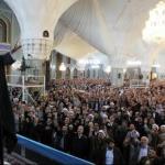 Iran's Supreme Leader, Ayatollah Khamenei waving hand to gathering of pilgrimages at holy shrine of Imam Redha in Mashhad. (Photo Credit: Khamenei.ir)