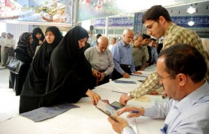 File photo shows people casting their votes in Iran's 10th presidential election, June 2009.