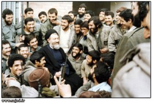 Ayatollah Beheshti talking between Iranian soldiers during Iran-Iraq war.