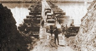 Egyptian military trucks cross a bridge laid over the Suez Canal on October 7, 1973, during the Yom Kippur War/October War