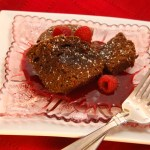Fudgy Dark Chocolate Brownies with Raspberry Sauce