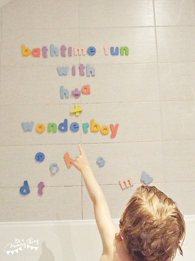 Child pointing at alphabet letter set