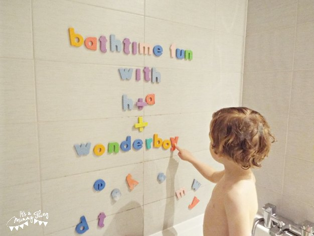 Photo of child pointing to letter set