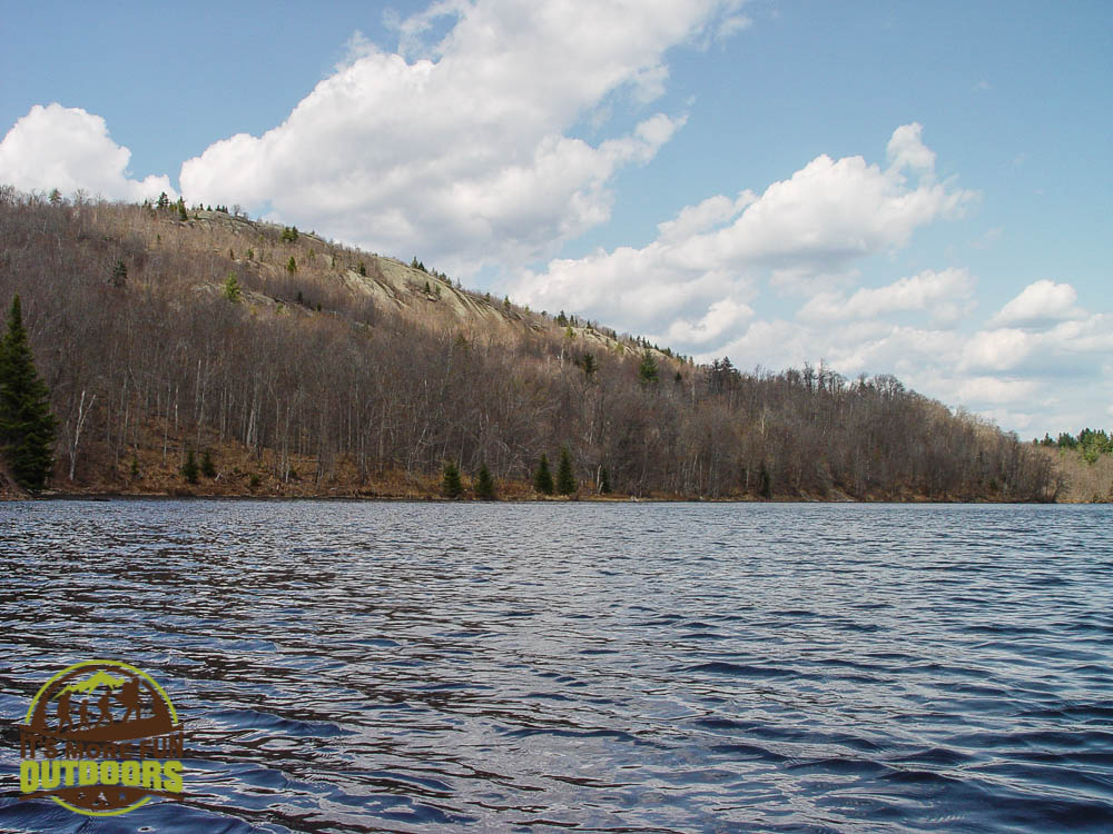 View of Low's Ridge from the river as we paddle back to the carry from camp. Bog River Flow Hike, Paddle, Camp! 2015