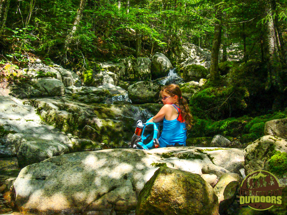 Trail Tip Tuesday: The First Family Backpacking Trip Tip #6: ensure your route has a series of rewards spread along bite-sized trail sections to keep their interest high. Dora enjoying a rest stop at a lovely waterfall along the trail.