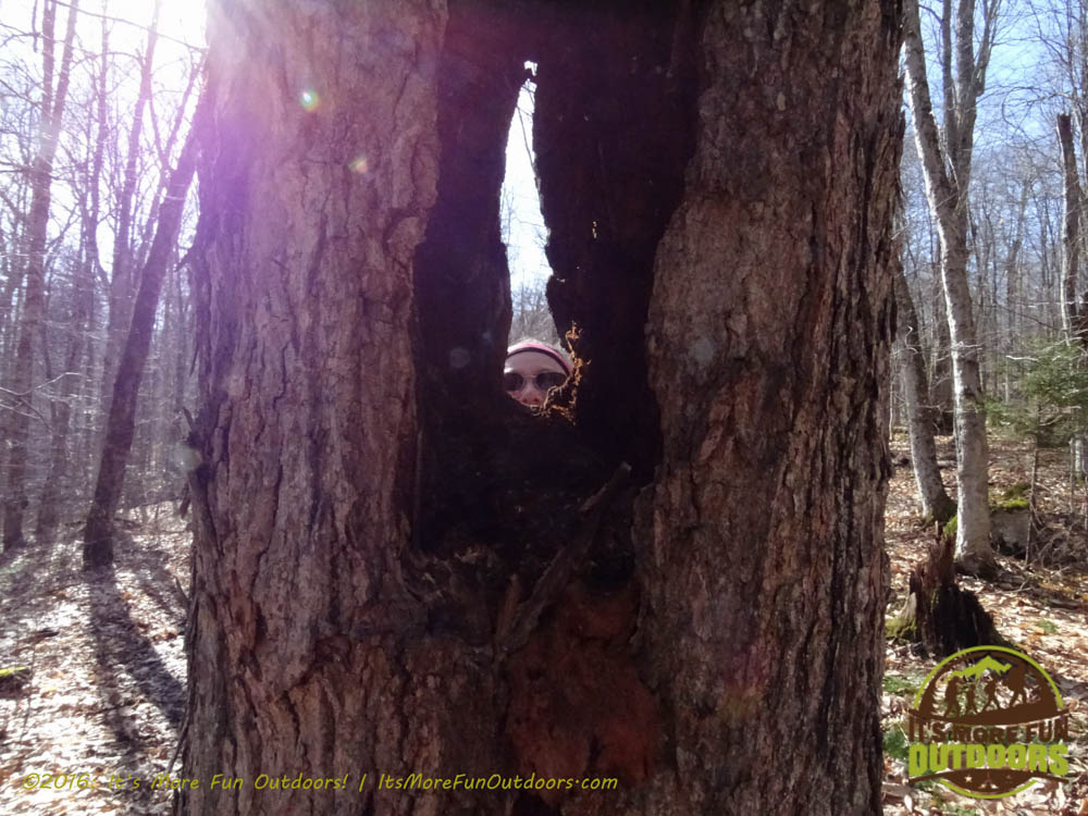 Our dear friend, Sylvia, peeking through 'the eye of the needle' ! Owl's Head Winter Fire Tower Challenge Hike, Long Lake, NY, Adirondacks, March 13, 2016