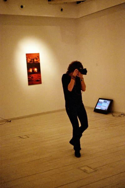 Photographer at an Exhibition