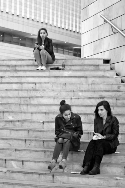 Three women sitting on stairs