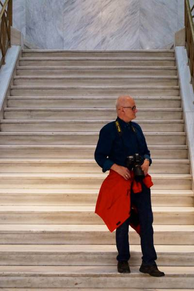 Man with Camera on Stairs