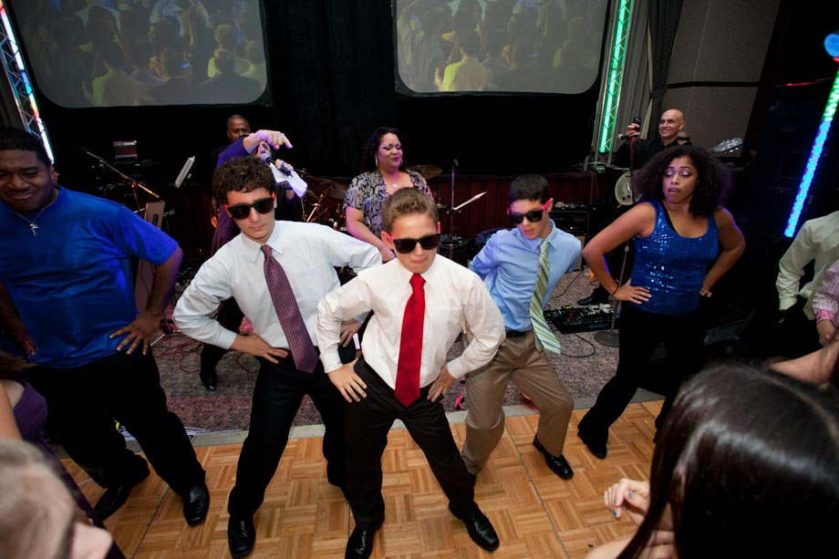 boys dancing at mitzvah party